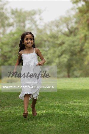 Little girl running in park