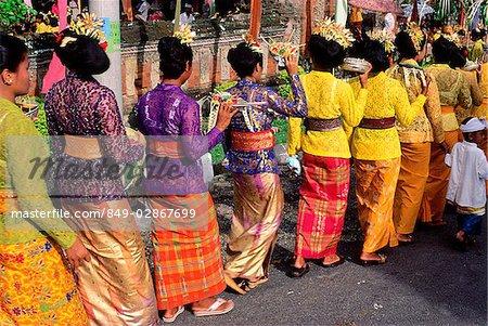 Indonesia Bali Candi Dasa Women In Ceremonial Dress Arrive At