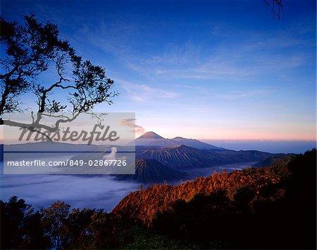 Indonesia, Java, Mount Bromo, Sunrise across Bromo-Semeru caldera from Mount Penanjakken. (grainy)