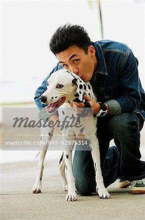 Man with Dalmatian dog, smiling at camera