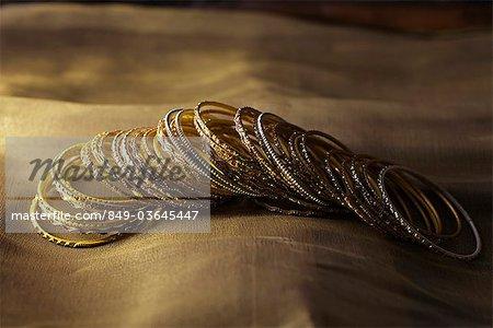 Gold bangles on gold sari