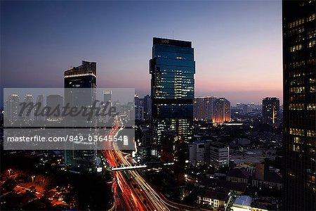 Evening view of CBD and skyscrapers along Jalan Jend Sudirman, Jakarta