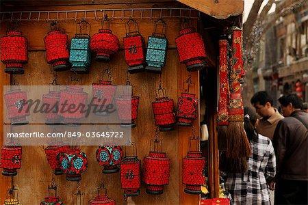 Red lanterns hanging on side of shop