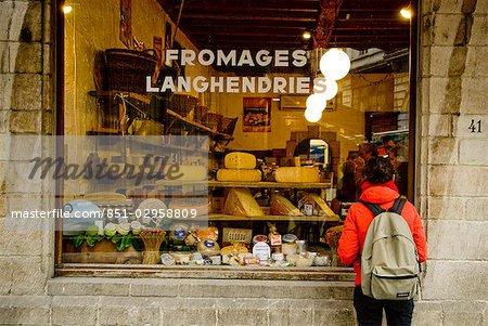 Tourist looking in Fromagerie shop window,Brussels,Belgium