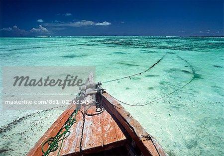 Old boat sitting in the shallow water off Matemwe on the north east coast of Zanzibar,Tanzania.