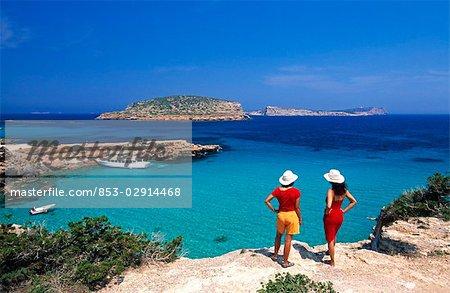 woman at the Cala Comte coast, Ibiza, Spain