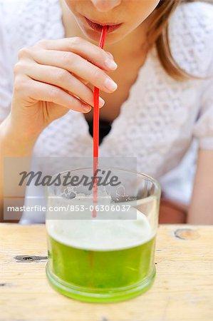 Young woman drinking Berliner Weisse in beer garden
