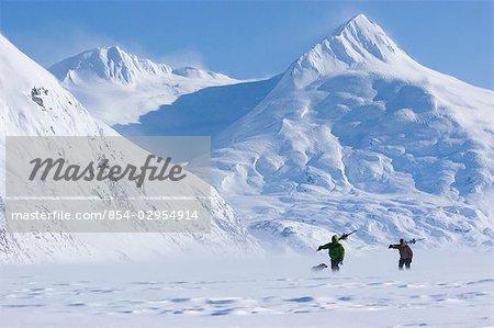Two skiers hike on Portage Lake
