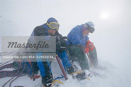 Mountain Climbers Rest in Snow Storm Chugach Mts SC Alaska Winter