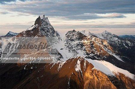 Aerial view of morning light illuminating the summit of Mount Doonerak in Gates of the Arctic National Park & Preserve, Arctic Alaska, Fall
