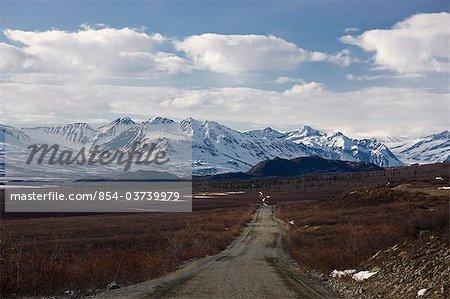 View of the Denali Highway climbing towards McLaren Summit, Southcentral Alaska, Spring