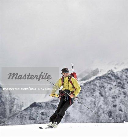 Backcountry skier on the glacier on the north side of Mt. Chamberlin, Brooks Range, ANWR, Arctic Alaska, Summer