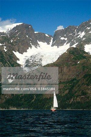 View of a sailboat on a sunny day in Resurrection Bay, Seward, Kenai Peninsula, Southcentral Alaska, Summer