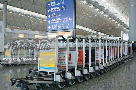 Luggage trolley at Hong Kong International Airport - Stock