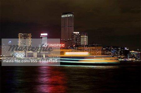 Tsim Sha Tsui East skyline at night with a sightseeing ship at foreground,Hong Kong