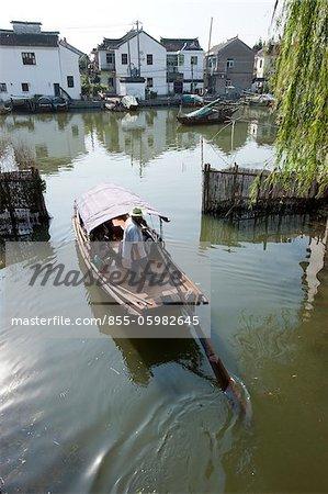 Tourist boats on canal, old town of Zhouzhaung, Kunshan, Jiangsu Province, China
