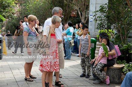 Tourists at Yuen  Po Street bird garden, Mongkok, Hong Kong