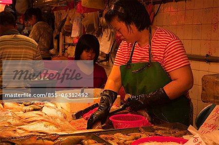 Fish seller at the red market, Macau