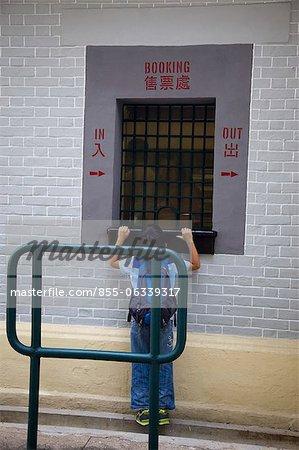 A boy visitor visiting the booking office, Hong Kong Railway Museum, Taipo, Hong Kong