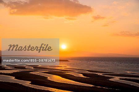 Tidal flats striped pattern in low tides at  the Matama coast, Bungotakada city, Kunisaki peninsula, Oita Prefecture, Kyushu, Japan