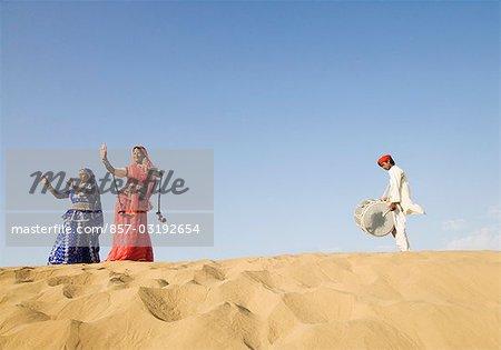 Performers performing in a desert, Thar Desert, Jaisalmer, Rajasthan, India