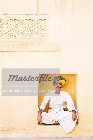 Man sitting in lotus position in a fort, Meherangarh Fort, Jodhpur, Rajasthan, India
