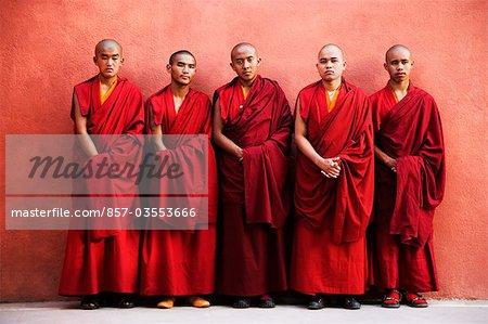 Five monks standing together, Bodhgaya, Gaya, Bihar, India
