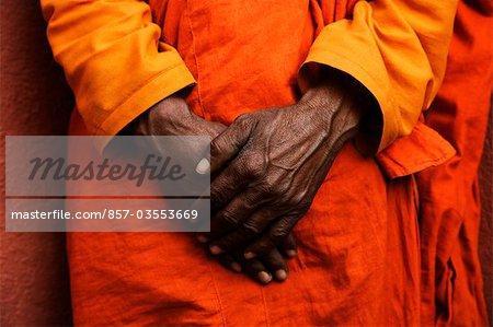 Monk standing with his hands clasped, Bodhgaya, Gaya, Bihar, India