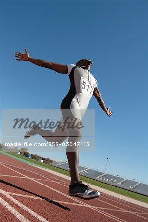 Sprinter Crossing the Finish Line