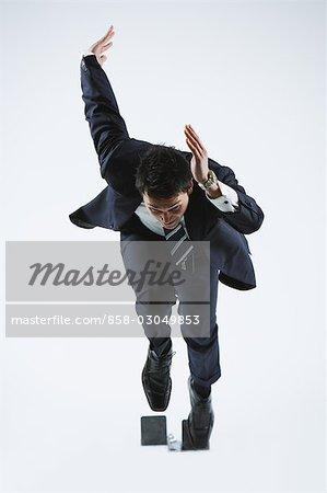 Businessman Leaving Sprinting Blocks