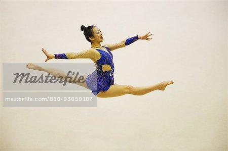 Young woman performing rhythmic gymnastics