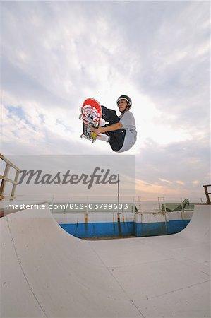 Skateboarders in mid-air