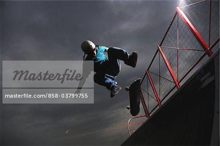 Skateboarder performing ollie trick