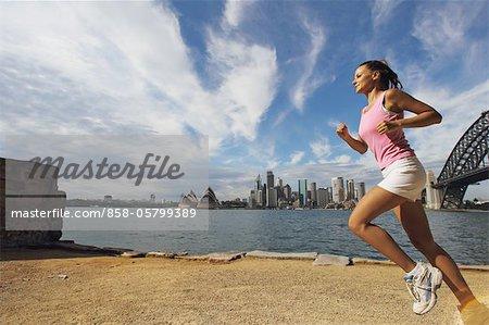 Young Woman Running at Sidewalk