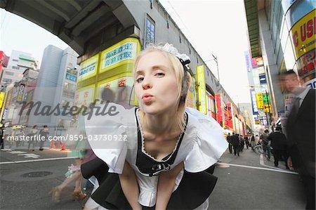 Maid Posing On Street