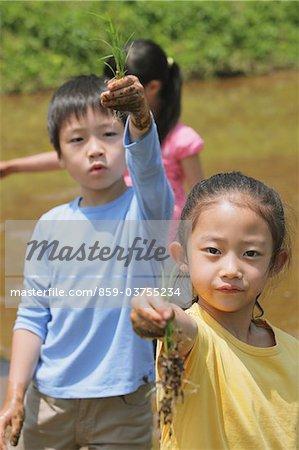 Kids Displaying Plant Seed