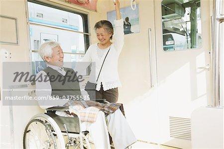 Elderly Couple On A Train