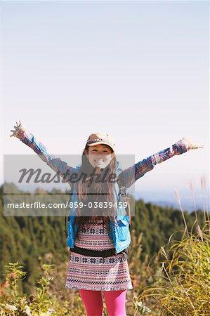 Young Woman Enjoying Nature Arm Raised