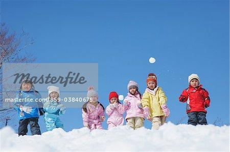 Children Throwing Snow Ball