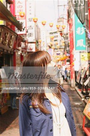 Japanese Women Walking In Chinatown's Street