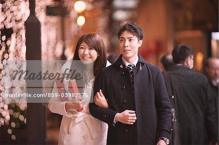 Japanese Couple Walking And Smiling