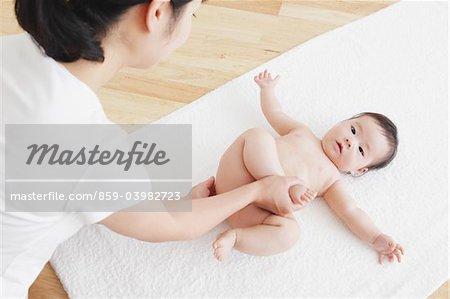 Mother Massaging Baby's Leg