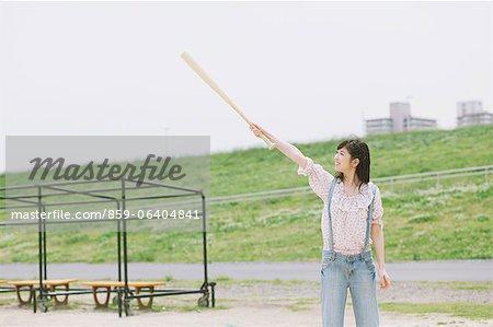 Japanese girl holding a baseball bat