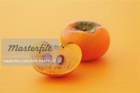 Japanese Persimmons on orange background