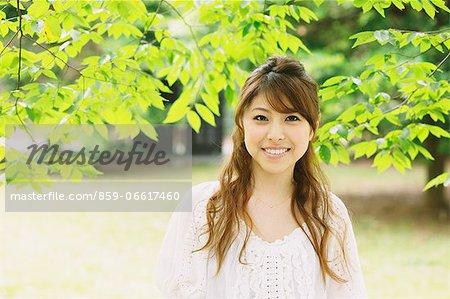 Woman Smiling at Camera With Fresh Green