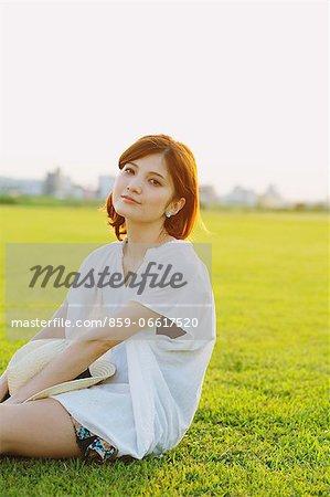 Woman Relaxing In Meadow