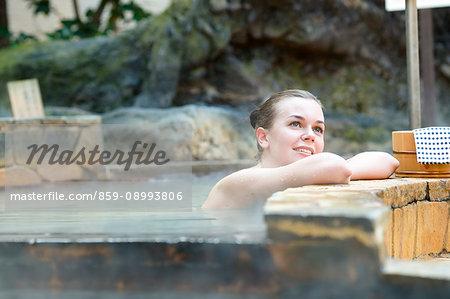 Caucasian woman bathing at traditional hot spring, Tokyo, Japan