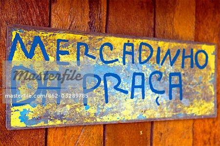 Brazil,Bahia,Boipeba Island. A sign for 'Mercadinho da Praca'.