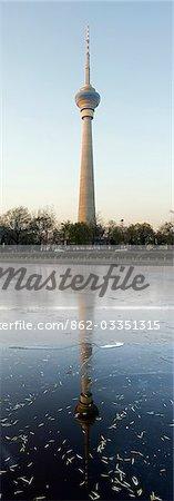 China,Beijing. The CCTV (China Central Television) tower reflected in the river at Yuyuantan Park.