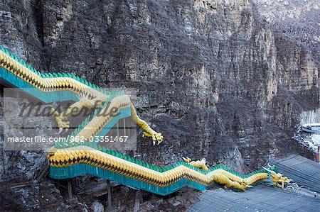 China,Beijing,Longqing Gorge Tourist Park. A dragon climbing down the mountainside.